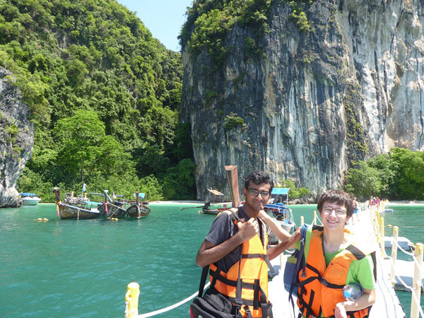 Two students standing on a boat in Thailand
