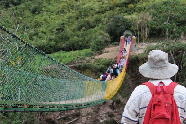 Students walking on a bridge in Bolivia